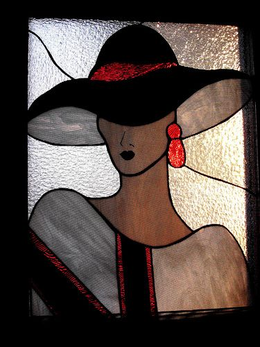 Stained glass lady by plattegal, via Flickr