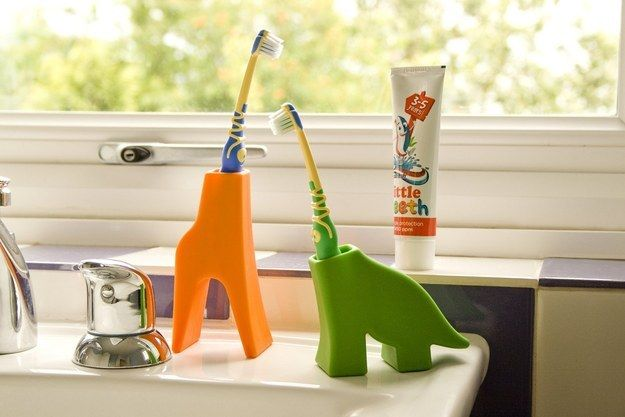 A holder that turns your toothbrush into a giraffe or a dinosaur.   32 Insanely Awesome And Inexpensive Things You Need For Your Bathroom