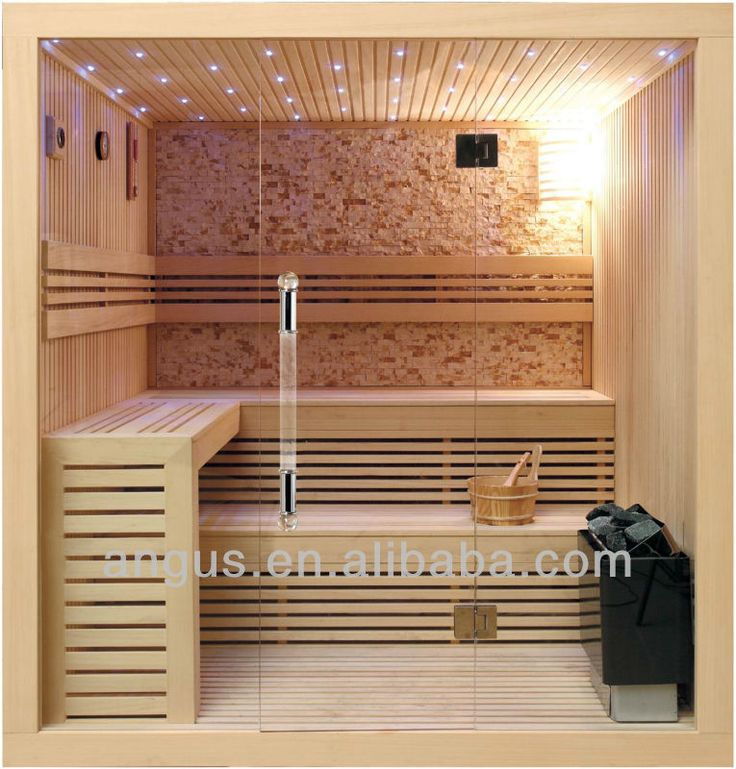 Light sauna with stone back wall