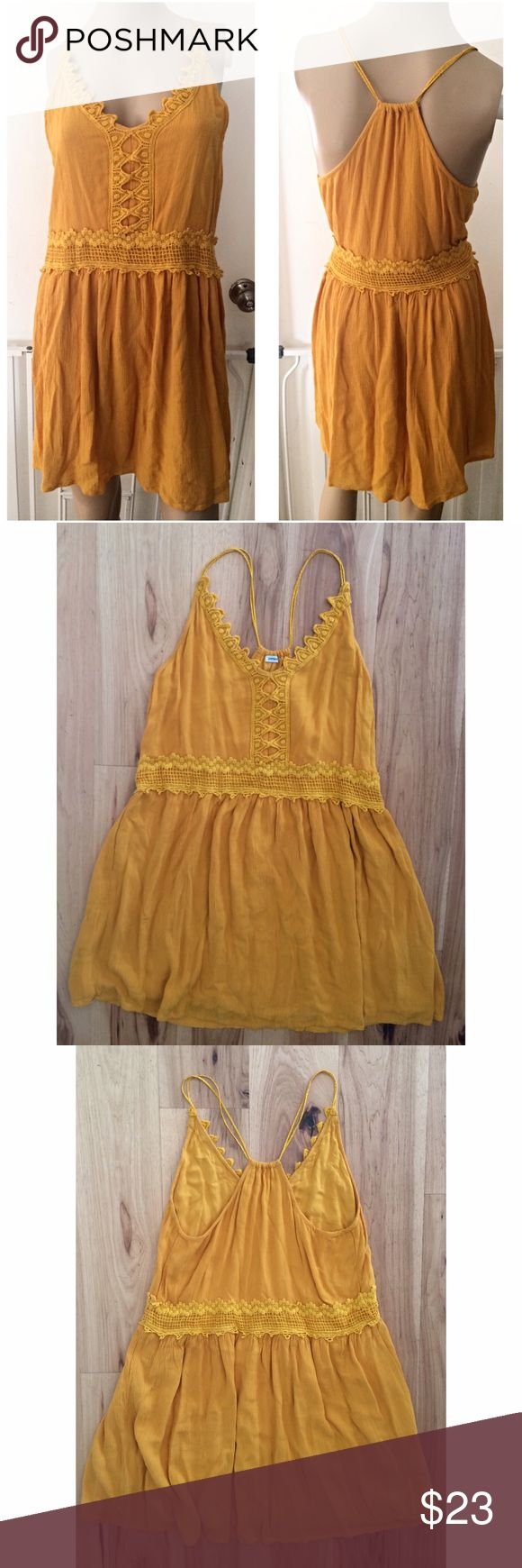 """Cute Pimkie Crochet Lace Racerback Dress In good pre-loved condition mustard yellow color crochet dress from UK brand Pimkie in size medium.  100% viscose material. Crochet detail in the breast and back of the dress. Drop waist with Racerback style. Lined underneath. Measure about 33"""" length, 15"""" pit to pit, 16"""" waist (estimate since this is more of a drop waist dress).❌Last pic of model is similar style from Pimkie. Actual dress are the last three pics.❌No trades or modeling. Open to…"""