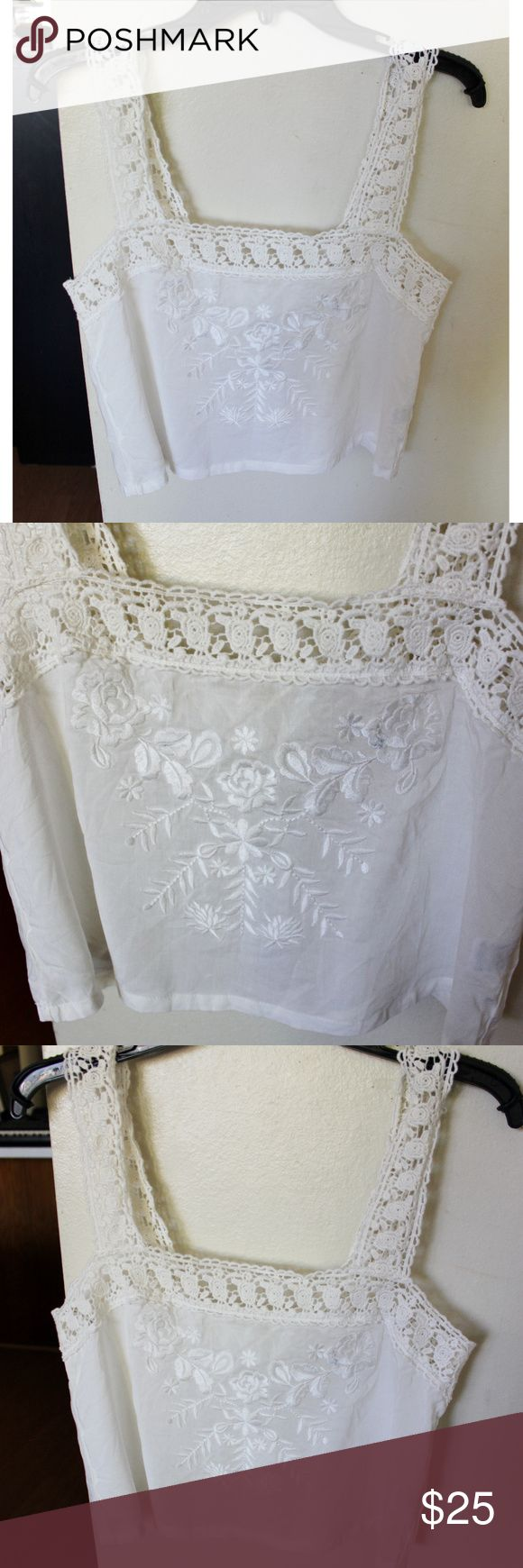 Millau Cream Embroidered Floral Flowy Crop Top M A Millau cream crop top in a size medium. Has crochet straps and has embroidered flowers on the front. Fits flowy and is semi-sheer. Very boho and cute. This brand is sold in stores like Free People and Anthropologie. The blouse is in new condition with its tag, the price was removed because it was a gift. Has some deep winkles that will probably need to be hand washed to remove. There are also 2 areas where it looks like there's a light stain…