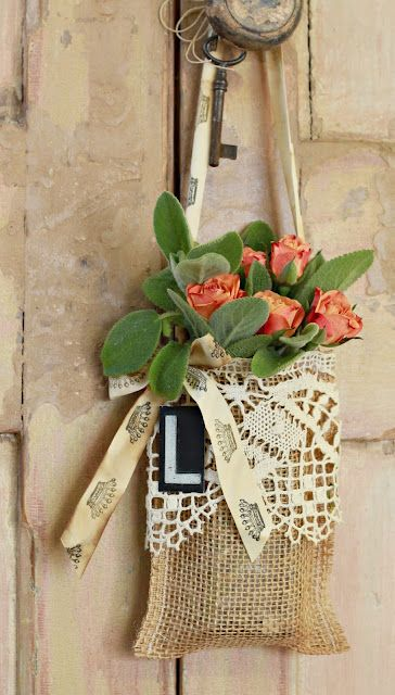 Burlap bag with long handle, lace, letter and imprinted ribbon.