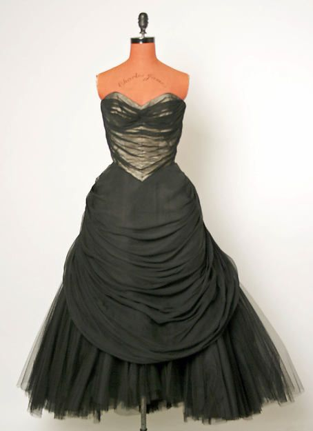 Ball gown Designer: Charles James (American, born Great Britain, 1906–1978) Date: fall/winter 1951–52 Culture: American Medium: silk, cotton, metal Dimensions: Length at CB: 46 3/4 in. (118.7 cm) Credit Line: Gift of Mrs. Lester Hano, 1958 Accession Number: C.I.58.32.1