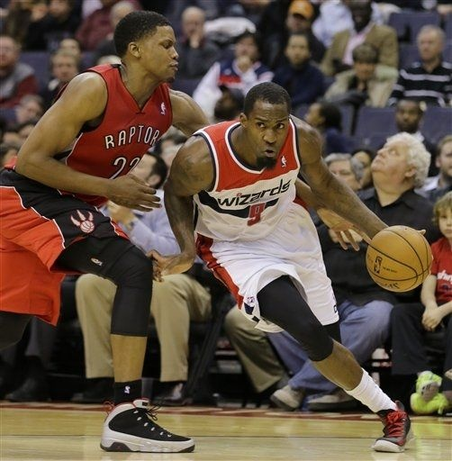 Washington Wizards forward Martell Webster (9) works to get past Toronto Raptors forward Rudy Gay (22) during the second half of an NBA basketball game Tuesday, Feb. 19, 2013 in Washington. Toronto won 96-88.