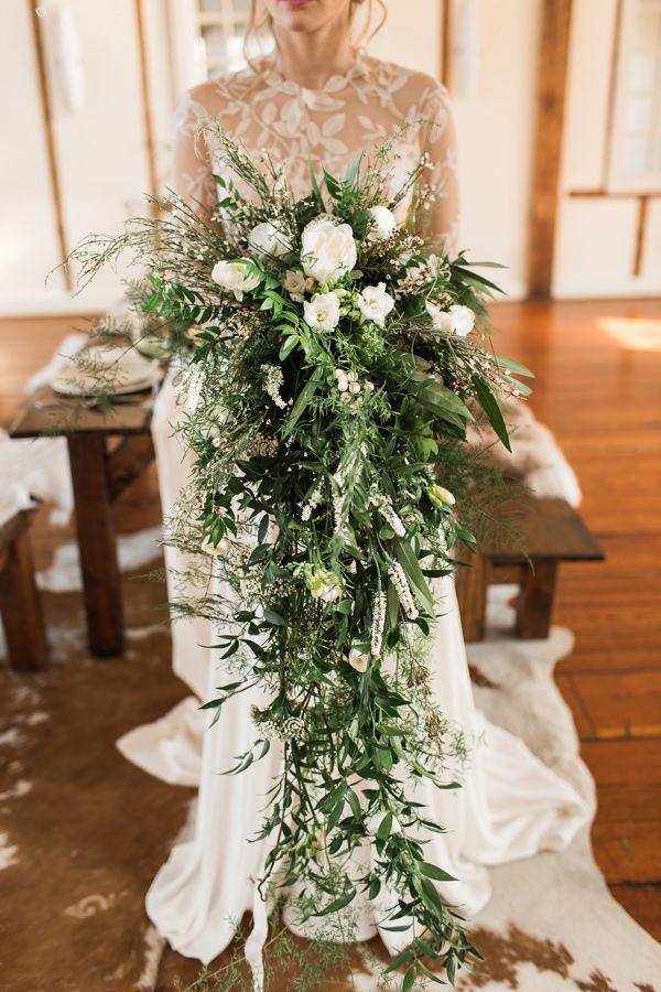 cascading greenery bouquet - photo by Samantha Jay Photography http://ruffledblog.com/swiss-chalet-wedding-inspiration