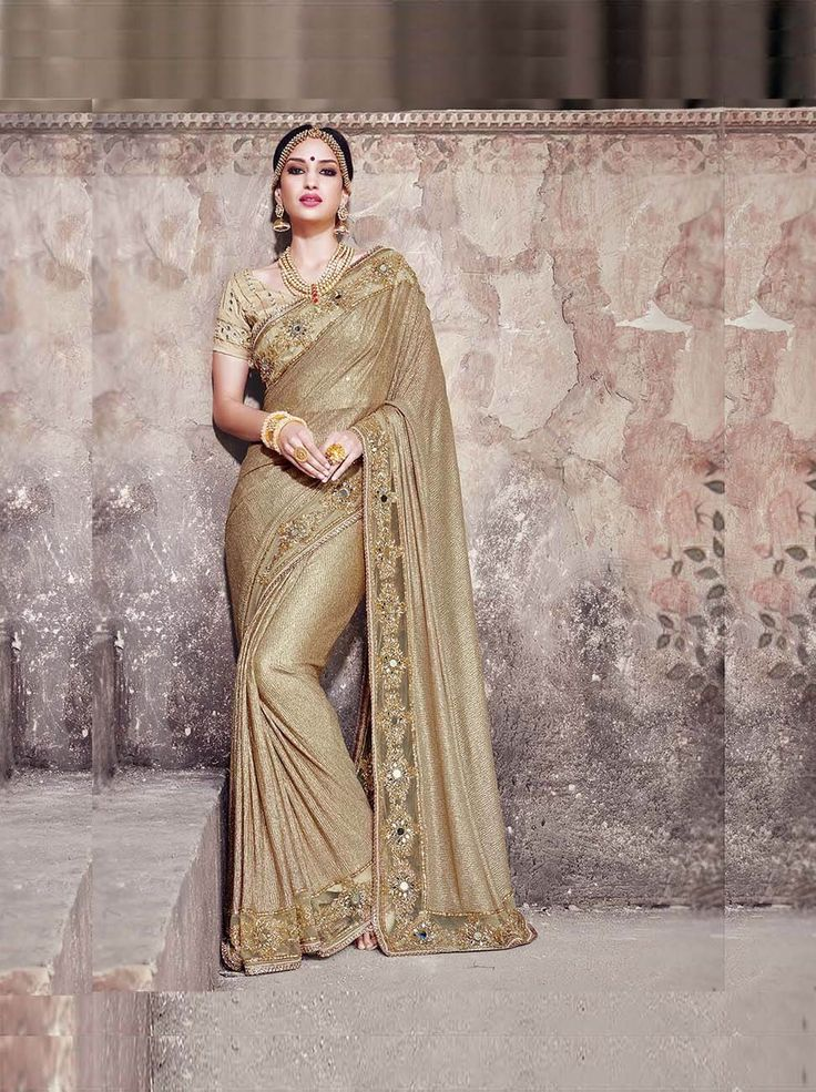 An exclusive saree for royal look. Golden imported fancy fabric saree with gota blouse
