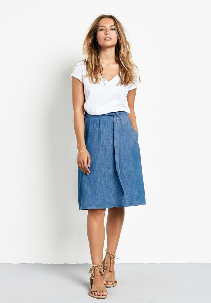 """Refresh your wardrobe for summer with our chic lightweight denim A-line midi skirt. Perfect paired with a cotton slub tee and nude sandals. •A-line fit, sits at your natural waist. Try your usual size. •Attached waist tie. •Zip back closure. •2 side pockets. •Midi length. •Model is 5'7"""" and wears size 8."""