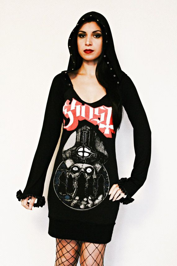 This awesome Ghost bc shirt features my signature hoodie design! I started with a licensed Mens t-shirt and hand cut it to a feminine form. I gave it an extra large, roomy hood and sewed black velvet eyelet tape along the border of the hood. I made extra long sleeves which peak at the top and bottom of the hands. Next, I sewed a lovely black satin box pleat trim all around each sleeve. Lastly, I gave it a bottom band of fabric. I used soft, light weight black viscose stretch fabric which…