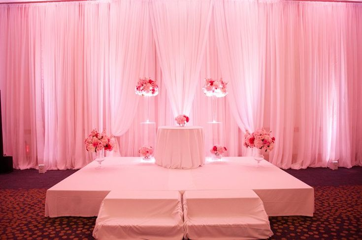 Modern ballroom wedding ceremony with pink uplighting at Westin Arlington (Naomi Lynn Photography)