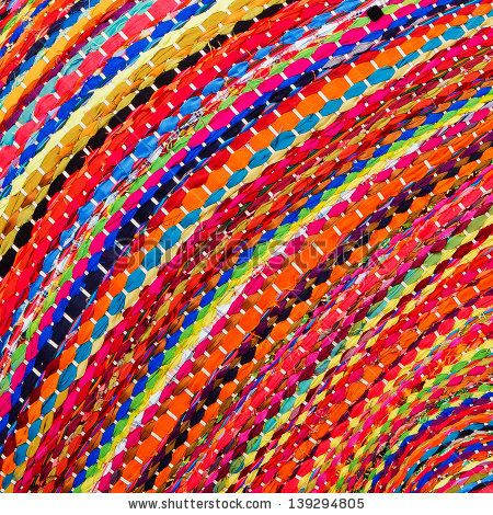 Colorful african peruvian style rug surface close up. More of this motif & more textiles in my port. by subin pumsom, via ShutterStock