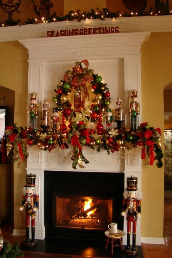 Beautiful nutcracker holiday mantel. I love how they carried the decorations all the way up.