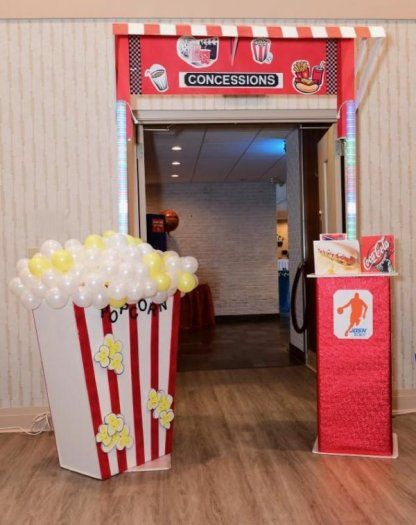 """This """"concession"""" stand made from balloons welcomed guests to the venue at this basketball themed Bar Mitzvah.    Bar Mitzvah Entrance 