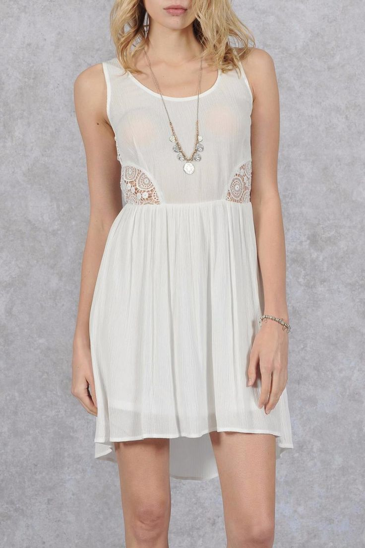 This cream sleeveless dress with lace back panel, and side cut-outs is perfect for any summer event. Pair with sandals and a sun hat for the weekend patio, or stroll through the park looking fine with booties and coral lipstick. You know you need it.   Sleeveless Lace-Back Dress by HYFVE. Clothing - Dresses Canada