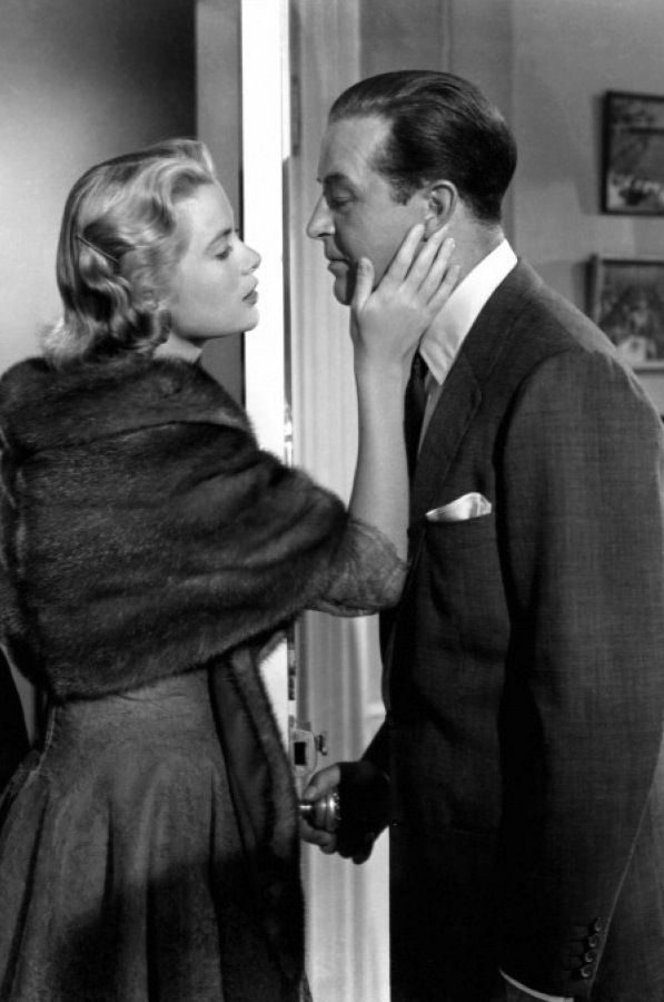 "Grace Kelly, 'Margot' kisses husband Ray Milland, 'Tony' goodbye in Alfred Hitchcock's ""Dial M for Murder"", (1954)."