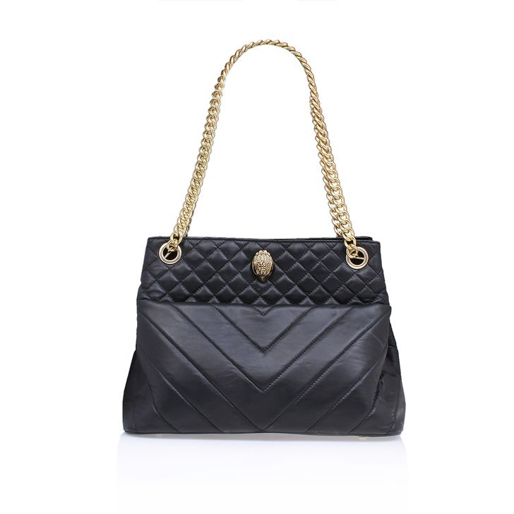 Black Tote Bag. Upgrade your handbag repertoire with the new Leather Kensington Tote by Kurt Geiger London. Mixing up chevron panels with plush micro quilting, this luxurious accessory features statement hardware for new-season nods.