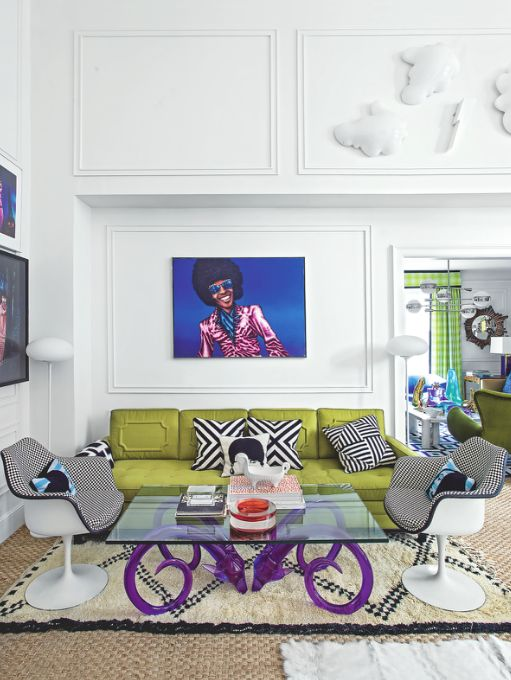 This funky living room is in designer Jonathan Adler's home. Modern furniture and pop-art inspired details show how to make a statement in a white-walled room. Image: Livingetc