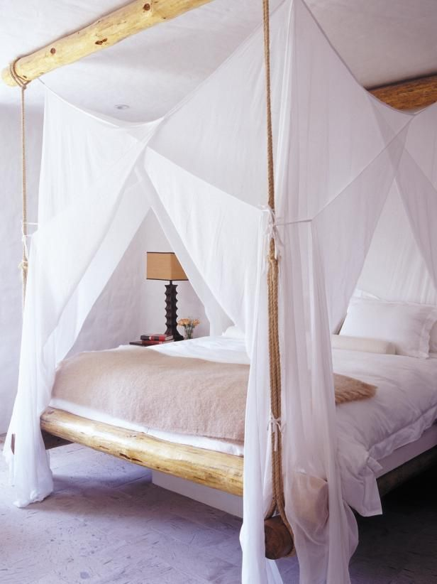 OBSESSED. See this rustic canopy bed with sheer draperies on HGTV.com.