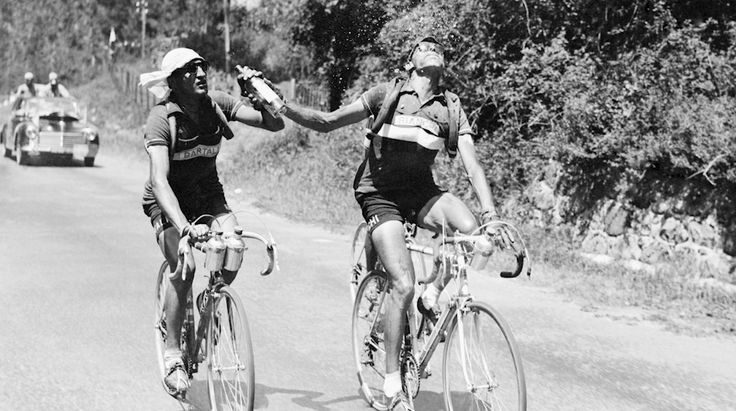 Gino Bartali & Fausto Coppi, Col D'Aubisque, 1949. The verdict is still out in Italy who gave the bottle to the other. The picture was in fact staged.