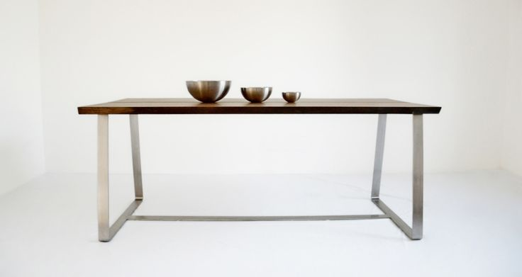 Solid wood table with stainless steel legs. Walnut wood.