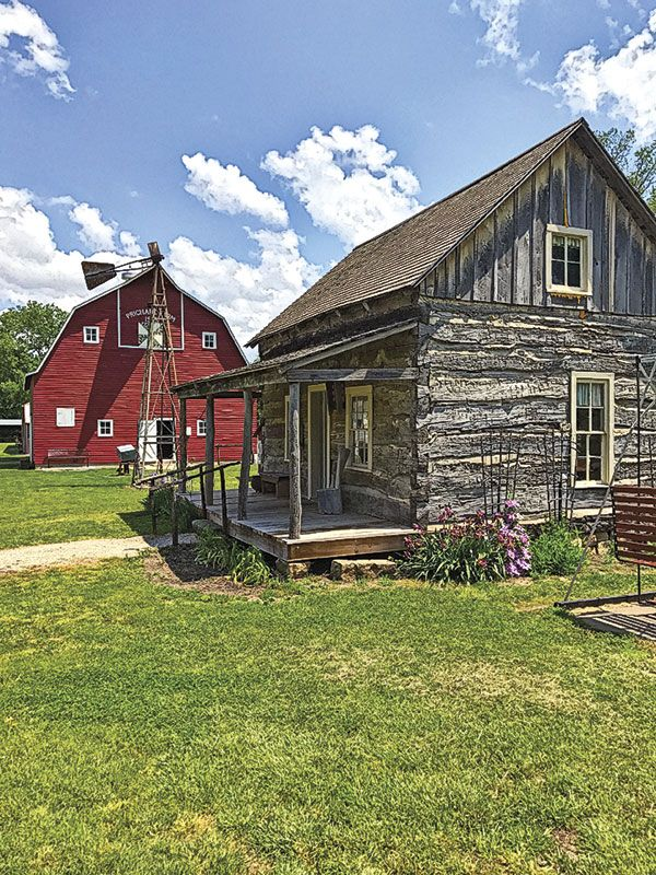 The Dickinson County Heritage Center has a museum, regularly scheduled living history demonstrations and a village of historic buildings, including the 1858 Volkmann Cabin (right, foreground), that tell the story of Kansas's settlement. – Courtesy Dickinson County Heritage Center –