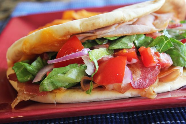 Turkey Bacon Ranch flatbread sandwich-lots of yummy flavors packed into crispy flatbread. A great lunch or quick dinner.