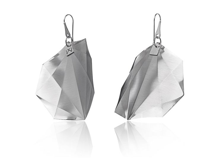 OCTAGON-DIAGONAL-RHODIUM  Hanger:  925 STERLING silver with rhodium flashing.   Pendant:  rhodium coating (platinum flashing) in 3 layers.   Satin finish surface with high gloss finish edges. Gloss preserving, wear-proof, oxidation resistant and anti-allergenic.  Available in three sizes: with a diameter of 4, 5 and 6 cms.