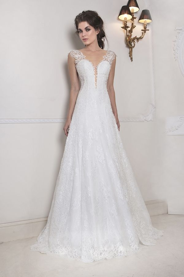 Ivory A-line dress made with a combination of applique French Guipure lace and Chantilly lace