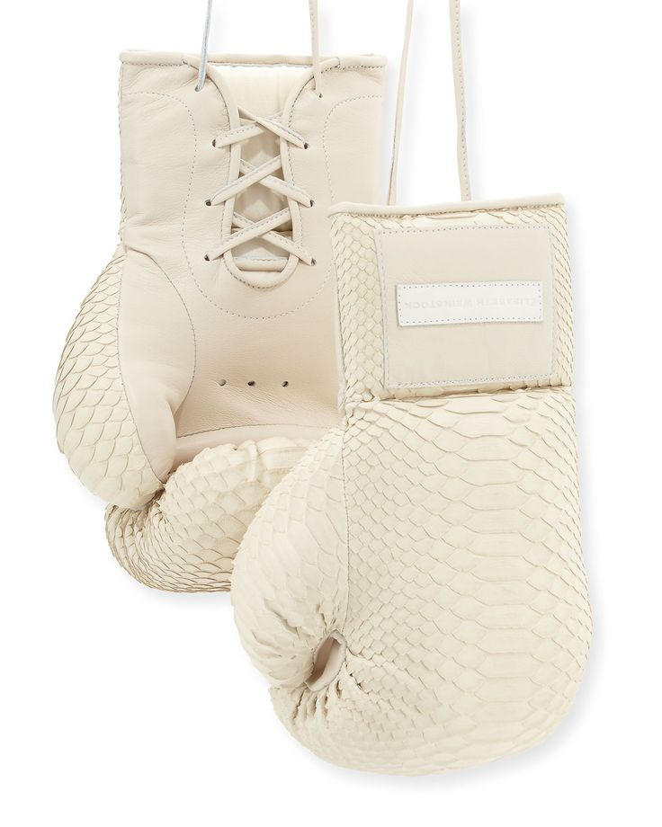Elisabeth Weinstock python boxing gloves. Lace-up at wrist. Leather logo patch at top. Made in USA of imported materials.