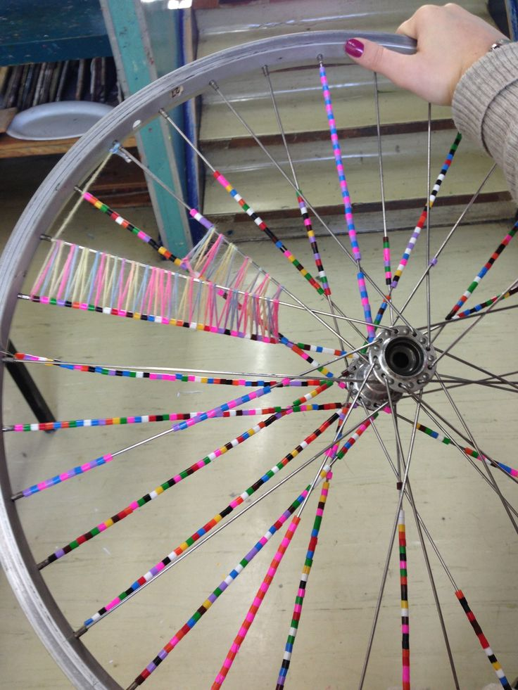 Recycled bike wheels, woven and beaded / collaborative project for early finishers.