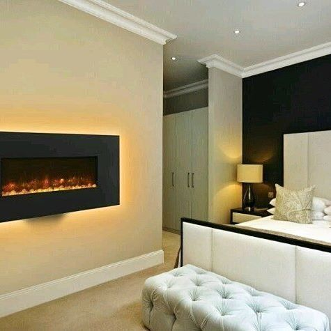 Fireplaces aren't just for living rooms... #fireplace #electricfire #fire #bedroom #chic #bed #cosy #home #duvet #pillows #warm