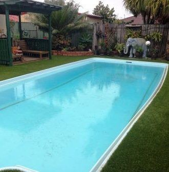 Pool surrounds laid with fake turf also known as synthetic turf, synthetic grass, fake grass, artificial turf, astro turf, artificial lawn, synthetic lawn