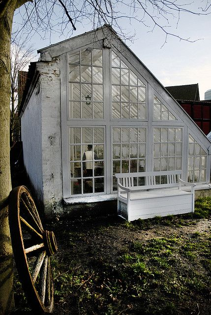 Antique greenhouse, potting shed, asymmetrical roof line