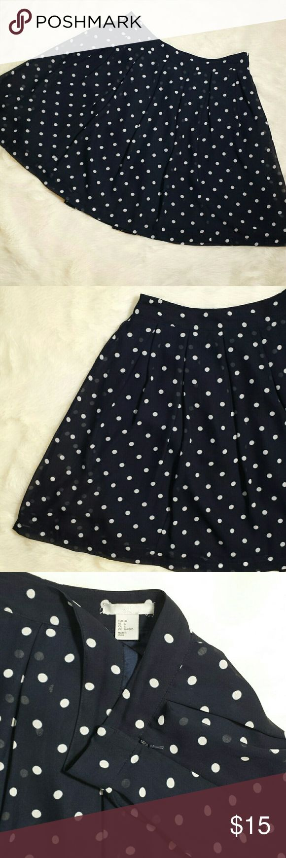 """H&M Polka Dot Pleated Skirt Size 6 Navy blue background with timeless white polka dot pattern. Pleated and a very full skirt. Side zip entry with double clasp closure. Sheer polka dot panel with fully lined solid underneath. Preowned in great condition with no rips, holes, tears or stains. Size 6.   Measurements  Waist 15"""" Length 19.5"""" H&M Skirts A-Line or Full"""