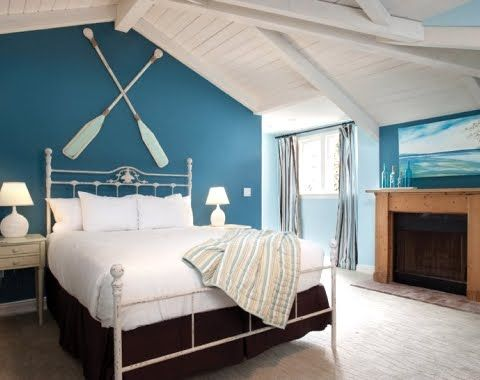 Blue And White Nautical Bedroom With Crossed Oars Above Headboard:  Http://www