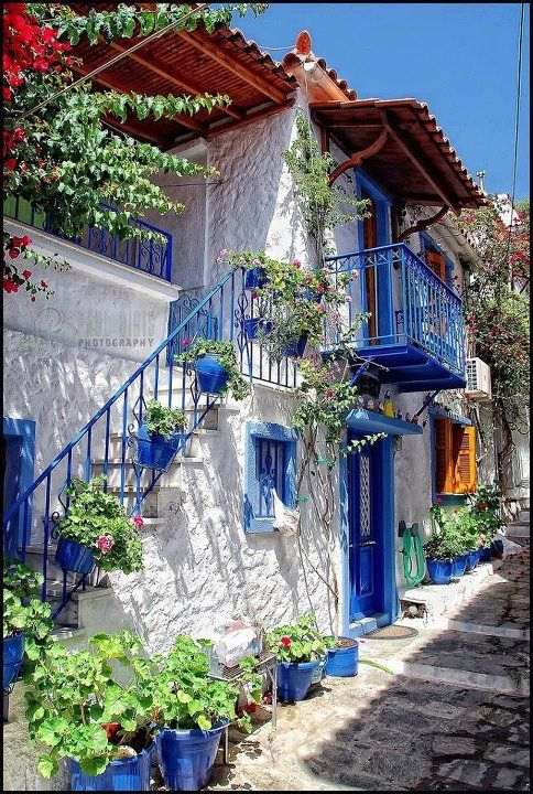 Euboea,Greece!! looooov that balcony, step railing, door/window trim and all the pots are painted blue!!!!!!!