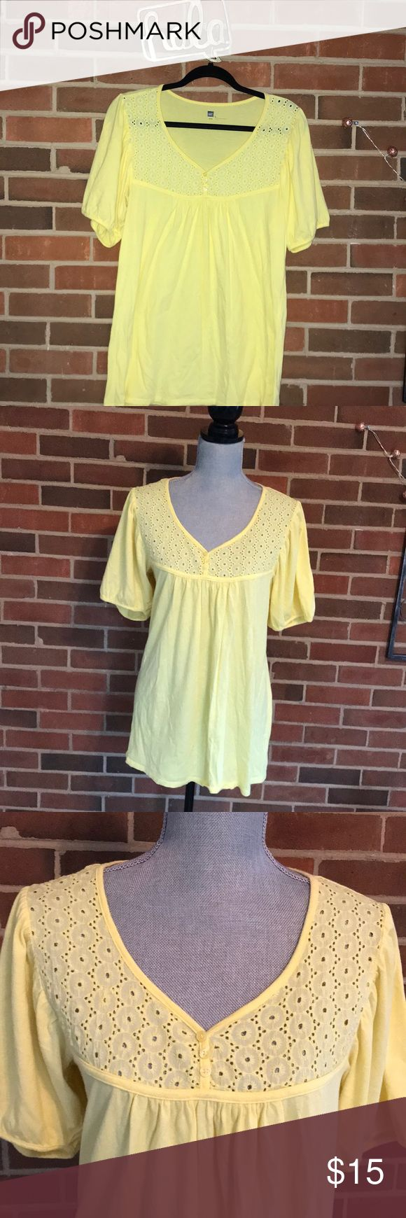 Gap T! Pale yellow short sleeve top with eyelet detail at neck! Slight pouf sleeve! Worn and washed a few times! GAP Tops Tees - Short Sleeve