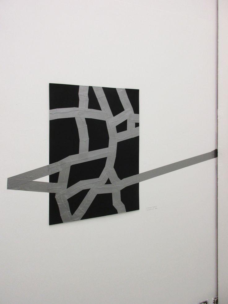 Carlo Colli, Recompose Black 5'15'', 2016, pittura nera strappata su carta e nastro americano grigio, 50x70cm. (interpretato nell'installazione dal gallerista  Piergiorgio Fornello di DieMauer a The Others Art Fair 2016, Torino)