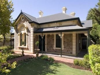 Bluestone colonial house exterior with verandah & landscaped garden - House Facade photo