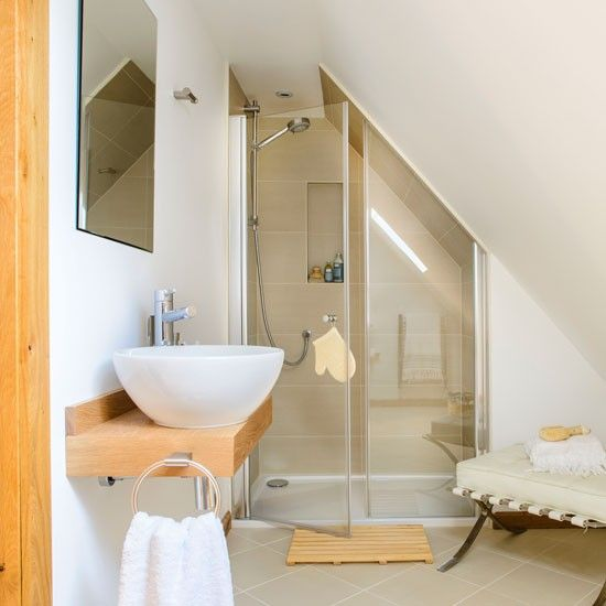A neutral shower room with sloped ceiling | Bathroom suites that make the most of awkward spaces | Room Ideas | PHOTO GALLERY | Ideal Home | Housetohome.co.uk