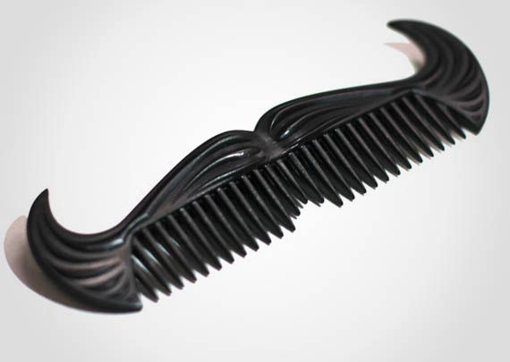 I already own a few combs, but if it's in the shape of a cowboy moustache, why not another?!