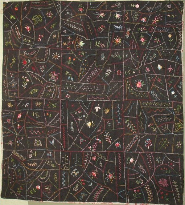 EMBROIDERED CRAZY TYPE ANTIQUE QUILT, black background