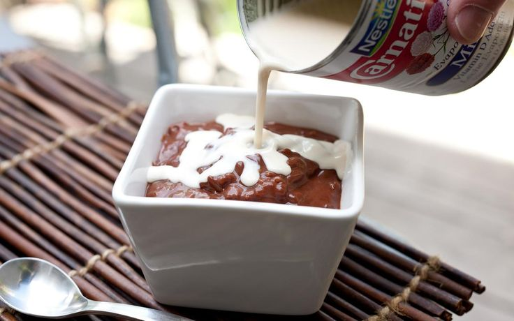 A Filipino recipe for champorado, or easy chocolate rice pudding, made with sticky rice and evaporated milk.