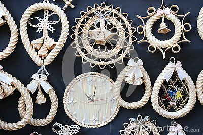 Twisted straw crafts - decorative handmade straw on black background.