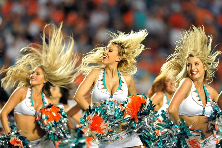 NFL cheerleaders dress up for Halloween  --  Miami Dolphins cheerleaders perform during a timeout the third quarter against the Cincinnati Bengals at Sun Life Stadium. (Steve Mitchell-USA TODAY Sports)