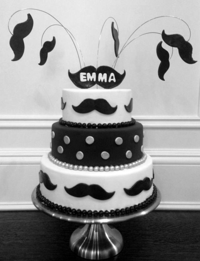 Mustache Bash Cake. So pretty! And I love the mustaches hanging off wire!