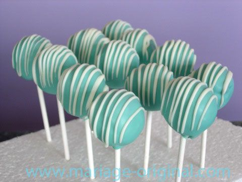 cake pops! We could do these in addition to the petite fours, doing the petite fours vanilla and the cake pops chocolate both with teal and white icing. Several neat options on this link. I kinda like them upside down with a black ribbon bow! ;-)