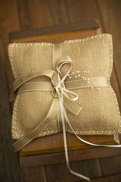 Tie your rings on a simple burlap pillow.