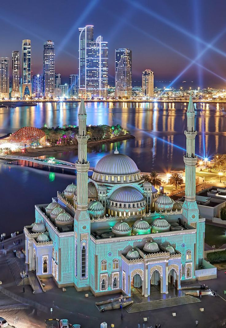 "Sharjah, the third largest city in the United Arab Emirates, radiates during the annual Festival of Lights. ""The Al Noor Mosque"", juxtaposes the lagoon and the corniche."