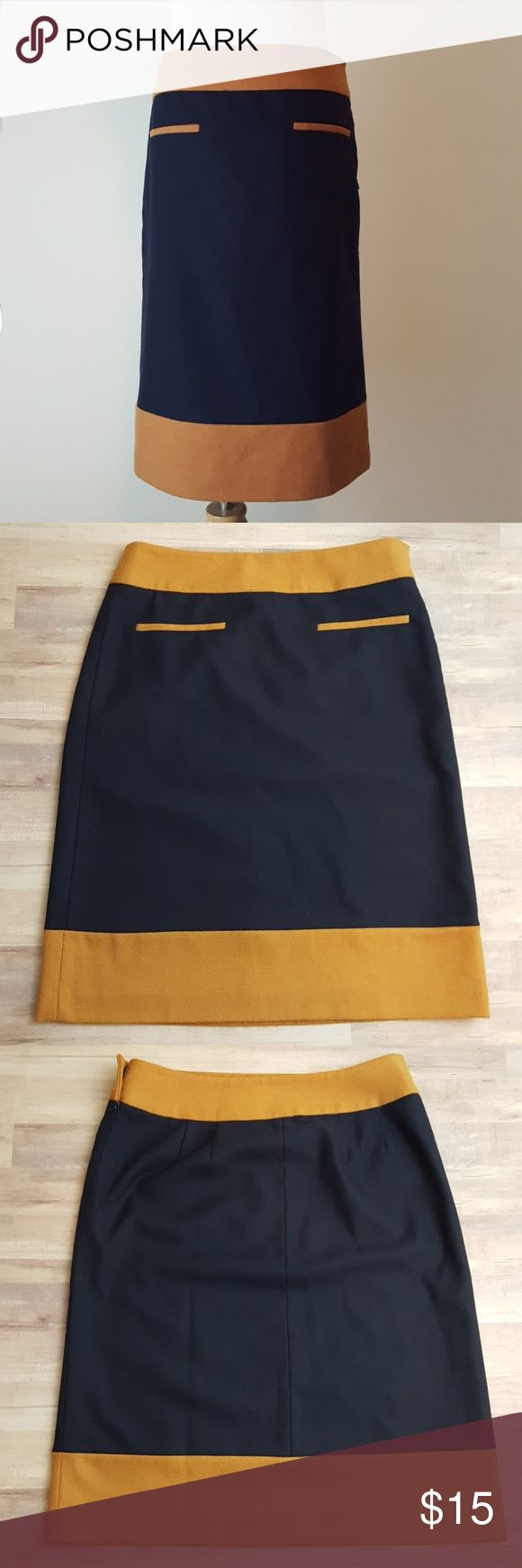 """Ann Taylor Loft Navy & Camel Skirt size 4 Pair with leggings ans knee high riding boots. Wool like feel. Size zipper and hook closure. Flat unopenes front pockets.  Size 4 Flat waist: 16"""" Length: 23.5"""" Ann Taylor Skirts Midi"""