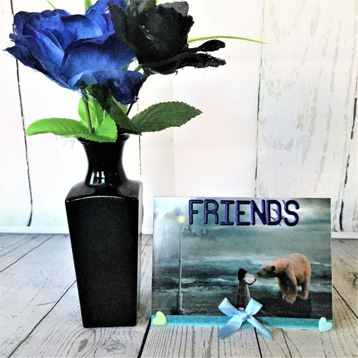 Adorable blank friendship card with a little girl befriending a polar bear.  Free postage